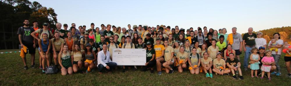 The College of William & Mary track teams, friends, family and other suporters gather with Charles and Ginny Crone at the 2017 Massey Cancer Center 5K, which was the event's 30th year.