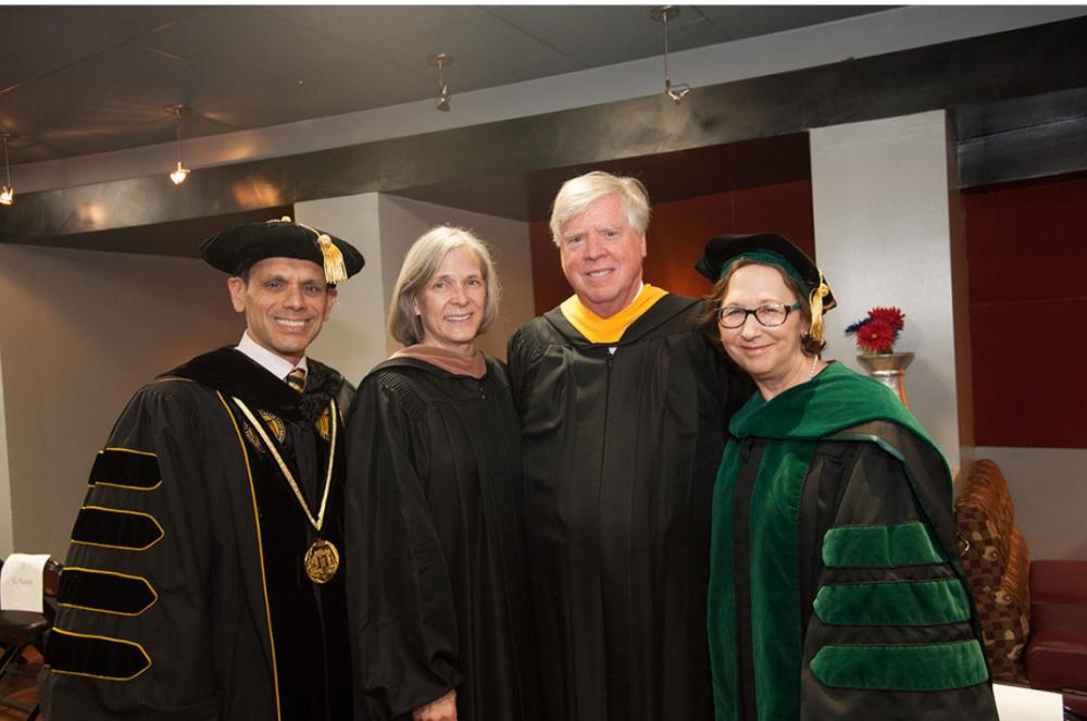 Ginny and Charles Crone (center) prepare for VCU's commencement on May 12 with Michael Rao, Ph.D., president of VCU and VCU Health System, and Marsha Rappley, M.D., CEO of VCU Health System and vice president of health sciences at VCU.