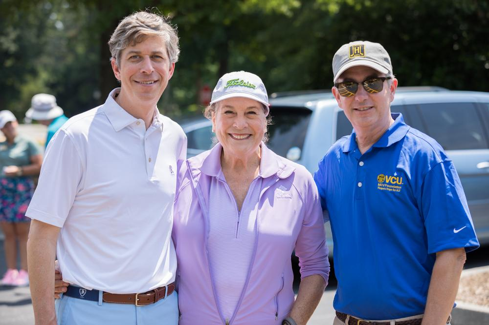 Landon Harper, Judy Brown and Brian Thomas prepare to hit the links at the fourth annual Harper's Hope Golf Tournament and Auction on June 8.