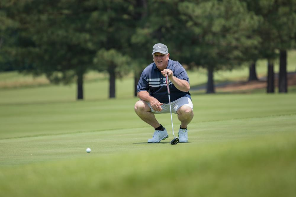 One of the 72 golfers who participated in June's Harper's Hope Golf Tournament and Auction sizes up a putt. Golfers and auction participants raised approximately $45,000 at this year's event.