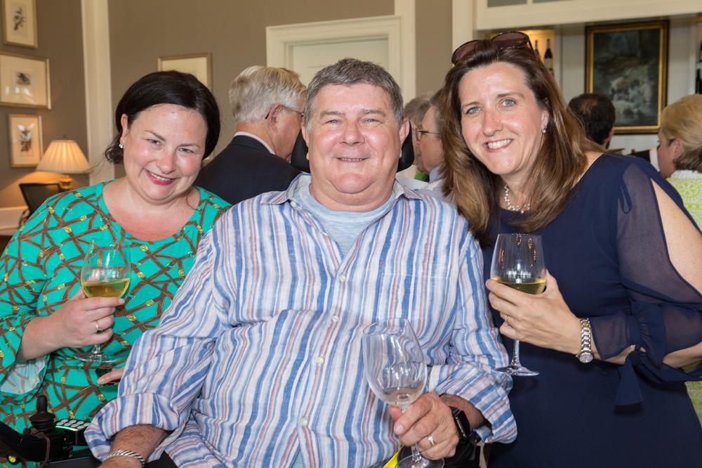Carrie Bickford, Jerry Creehan and Michelle Gebhardt share a moment at the Harper's Hope Golf Tournament and Auction reception. In 2017, Jerry was one of the first three patients in Virginia to receive a newly approved drug to treat ALS. Since then, many more VCU Health patients have received the drug