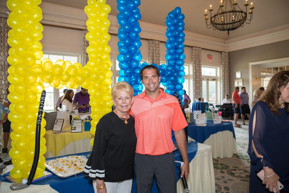 Anne Harper spends time with Dr. Scott Vota at the Harper's Hope Golf Tournament and Auction reception. Dr. Vota is director of the Neuromuscular and ALS clinics at VCU Health and treated Anne's late husband Vic.