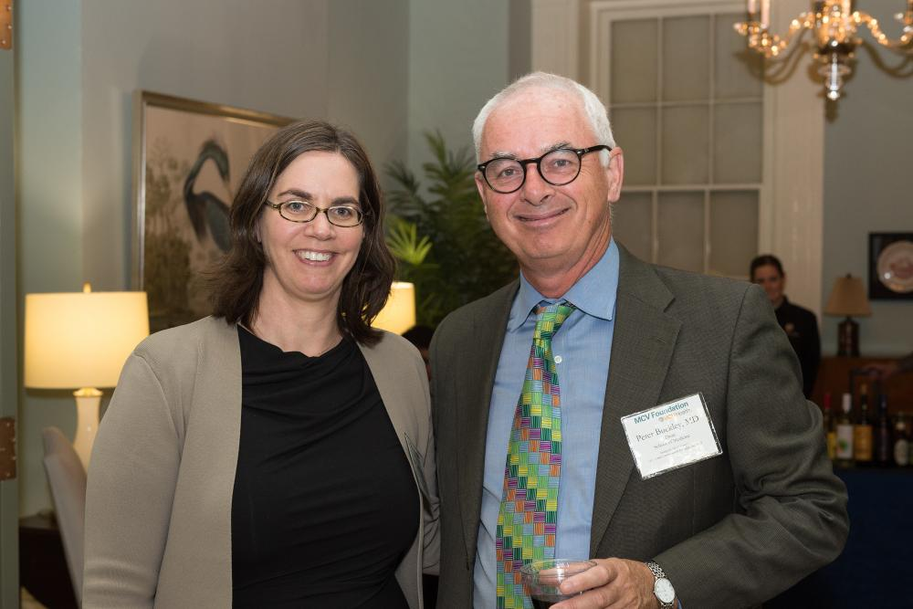 April Kimmel, Ph.D., and Dean Peter Buckley of the VCU School of Medicine.