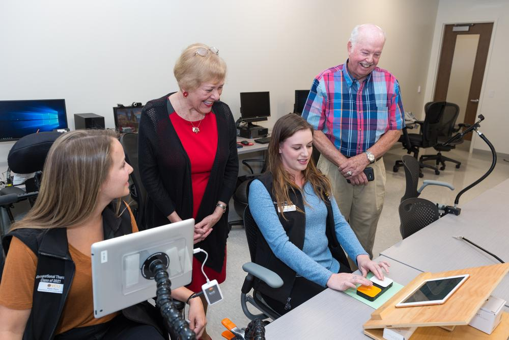 Jack and Carlyn Dalness interact with occupational therapy students in the VCU College of Health Professions Herbert and Charlotte Meyer Assistive Technologies Laboratory & Quiet Room, which was named in honor of a WWII veteran wounded during the D-Day invasion of 1944 who benefited from OT treatment. Photo: Kevin Schindler
