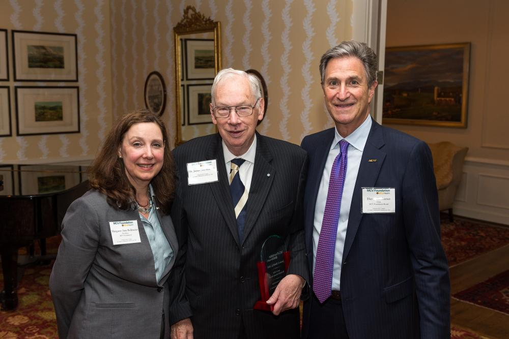 James Shield Jr., M.D. (center), holds his Dowdy Award alongside Margaret Ann Bollmeier, MCV Foundation president, and Harry Thalhimer, MCV Foundation board chair, at our annual dinner and awards ceremony.