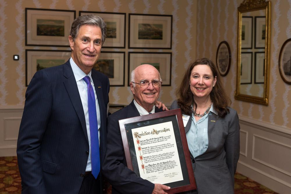 Harry Young, M.D. (center), who wasn't able to attend last year's annual dinner when he was awarded lifetime honorary trustee status, stands this year with Harry Thalhimer and Margaret Ann Bollmeier after receiving his proclamation.