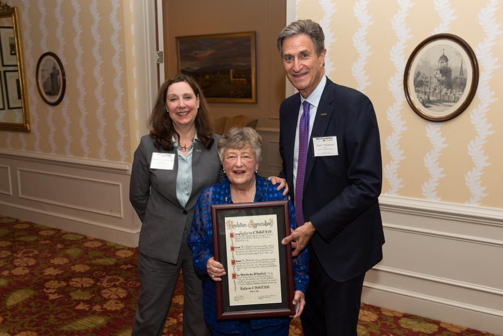 Kathy Bobbitt, Ed.D. (center), looks over her lifetime honorary trustee proclamation with Margaret Ann Bollmeier and Harry Thalhimer.