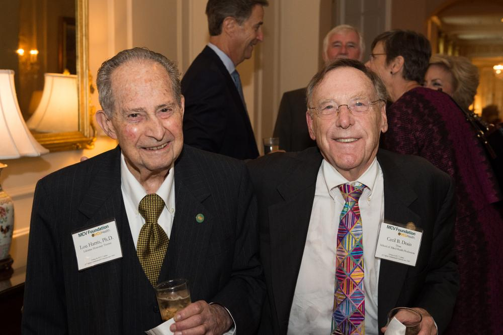 Dean Cecil Drain (right), Ph.D., who could not attend this year's dinner, spends time with Lou Harris, Ph.D, at our 2017 dinner and awards ceremony.