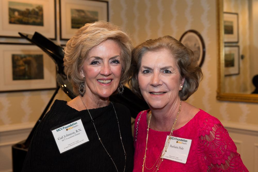 Gail Johnson, RN (left), who could not make it to this year's dinner and awards ceremony, speaks with Barbara Hale at the 2017 dinner.