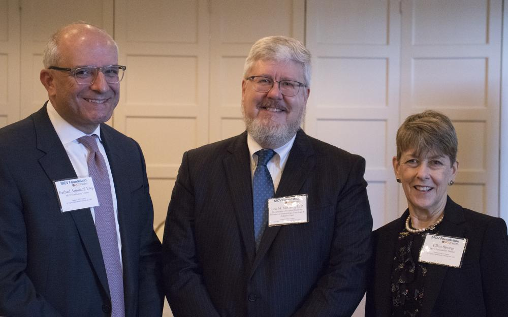 Farhad Aghdami (left) and Ellen Spong (right), both MCV Foundation board members, welcome John McCarty, M.D., to speak at a recent MCV Foundation event.
