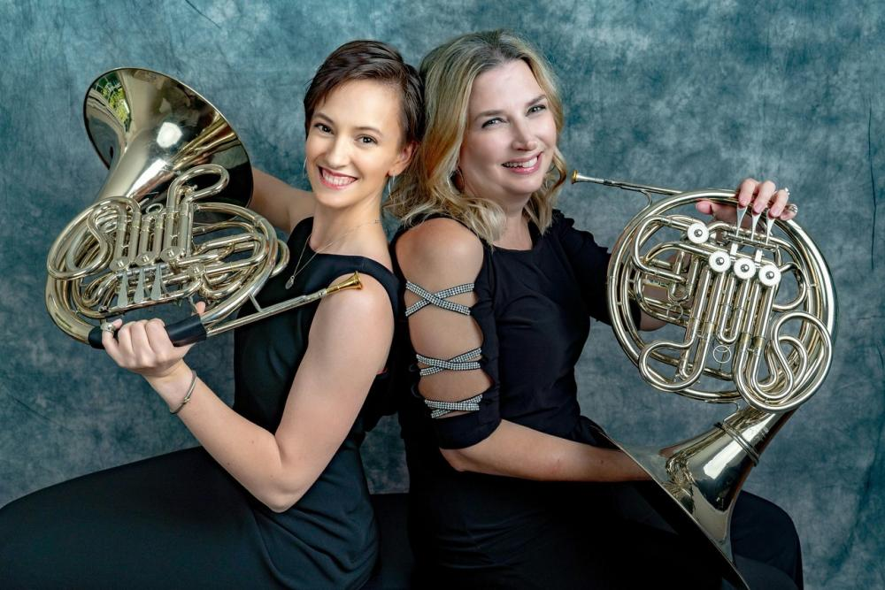 Kara Dods (left), an M.D./Ph.D. student and French hornist, poses with Theresa Erichsen, a registered nurse and fellow French hornist. Theresa is a co-founder and manager of the VCU Health System Orchestra and Kara is the librarian. Photo: Drs. Mimi Peberdy and Joe Ornato