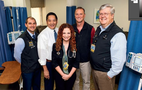 Leadership of the VCU Massey Cancer Center CAR T-cell therapy team includes (left to right) Gary Simmons, D.O.; Harold Chung, M.D.; Christina Wiedl, D.O.; William Clark, M.D.; and John McCarty, M.D. (not pictured, Amir Toor, M.D., and Judy Davis, R.N.). Photo: Kevin Schindler