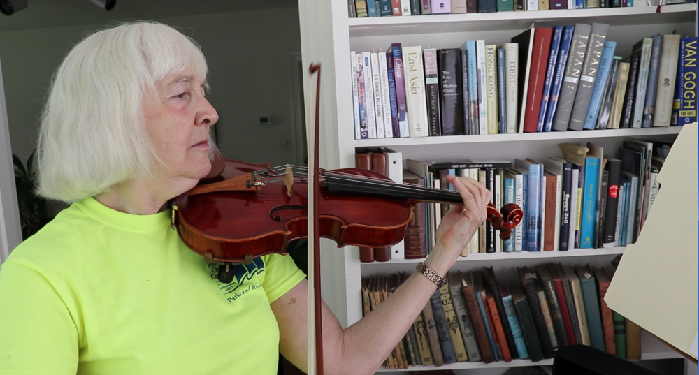 Nancy Canning plays a Scottish fiddle tune at her house in Williamsburg. When Nancy experienced severe depression in 2016, she stopped playing music and severed ties with several other favorite activities. Since her recovery, she has formed a quartet to play classical music and has also taken up the Scottish fiddle