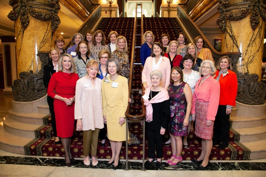 Adrienne Maxwell (front-center, in yellow), has dedicated her time and leadership to the Massey Cancer Center for almost 30 years. Here she stands with members of the Women & Wellness Legacy Committee in 2019.