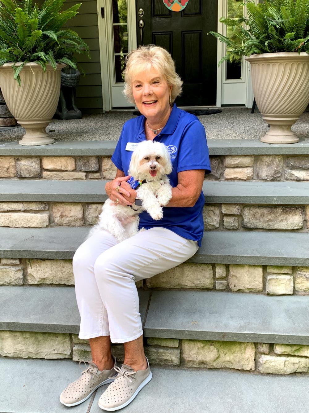 Joan Nuttle and Stewie the Maltese