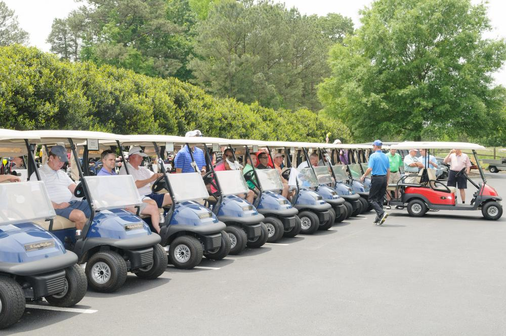 Golf carts lined up at the Harper's Hope tournament