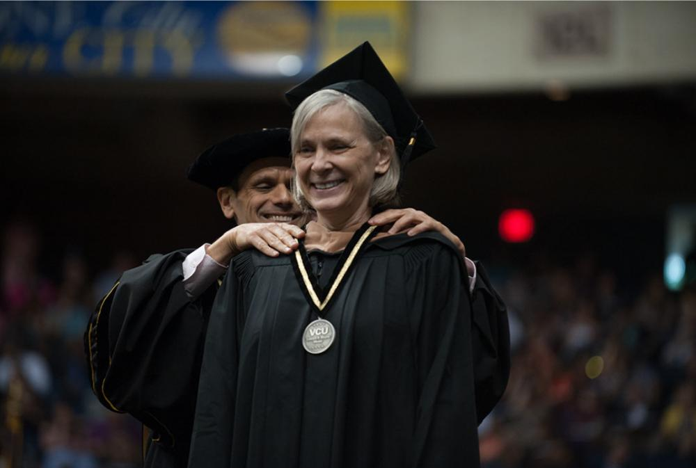 Ginny Crone receives the Edward A. Wayne Medal at VCU's commencement on May 12.