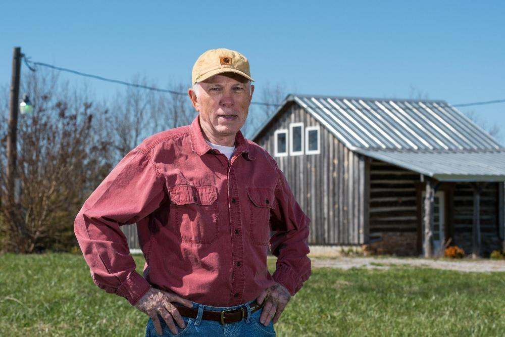 Dr. Duffer in rural Virginia. Barn in background.