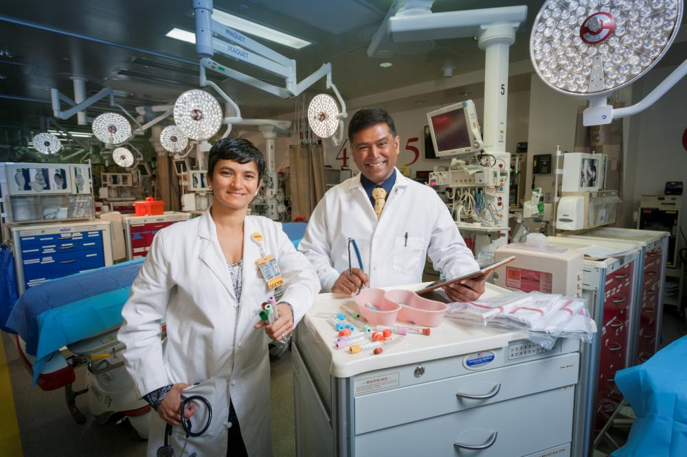 "VCU Health trauma surgeon Sudha Jayaraman, M.D., and VCU School of Pharmacy assistant professor Dayanjan ""Shanaka"" Wijesinghe, Ph.D., collaborate on using mass spectrometry as a new method of analyzing what medications are in a patient's blood. Photo: Karl Steinbrenner"