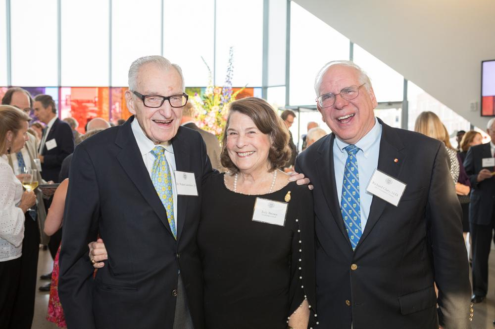 Walter Lawrence Jr., M.D. (left), founding director of VCU Massey Cancer Center; Judy Brown, MCV Foundation Leadership Council member; and Richard Clary, M.D., MCV Foundation board member, converse at the 2019 MCV Society reception. Photos: CSI Studio LLC