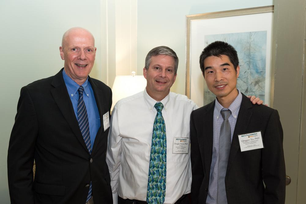 Blick Scholar Qingguo Xu with Dean Joe DiPirro and Douglas Sweet from the VCU School of Pharmacy